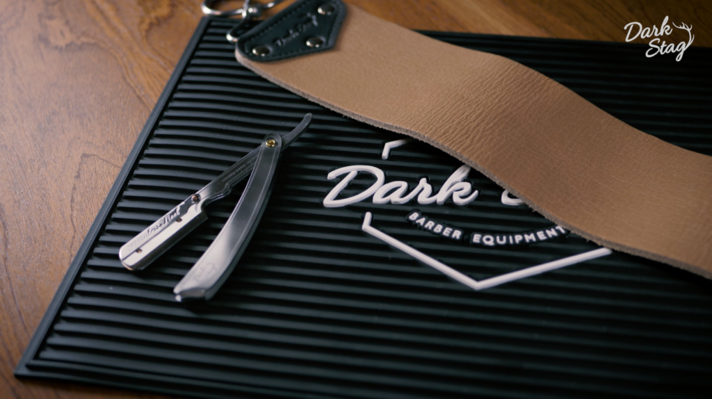 The Dark Stag Premium Razor on the Rubber Barber Station Mat, with the Buffalo Leather Strop
